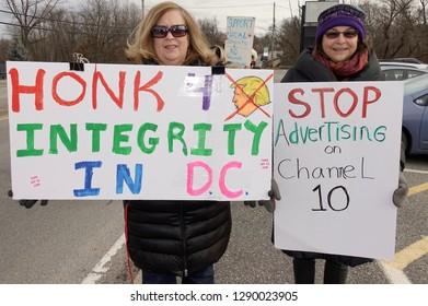 WARWICK, RHODE ISLAND/USA- JANUARY 19, 2019: Rhode Island ReSisters rally to protest Donald Trump, Sinclair Broadcast Media, WJAR TV 10, climate change, and gun control.