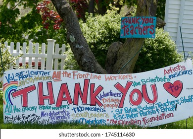 WARWICK, RHODE ISLAND/USA- MAY 17, 2020:Outdoor lawn signs thank frontline workers, teachers, mail carrier, and friends during the Coronavirus Pandemic of 2020
