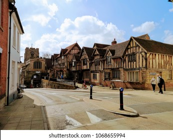 Warwick, UK - April 14, 2018 : Sunny day in Warwick Coventry, Old hospital houses and Jaguar Land Rover Cars, It is very old town in UK