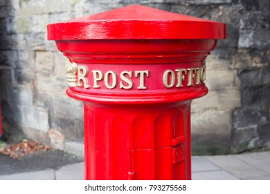 WARWICK, UK: DECEMBER 24 2017, Historic pillar Box that was cast in 1856 at the East Gate, Warwick, England
