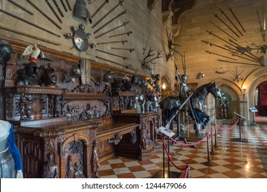Warwick, UK - July 2018: Warwick Castle, The Grand Hall, display of artefacts including various armour and weapons
