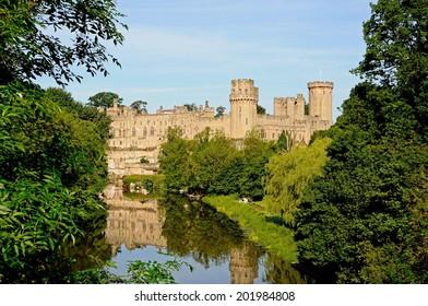 WARWICK, UK - JUNE 12, 2014 - View of Warwick castle and the River Avon, Warwick, Warwickshire, England, UK, June 12, 2014.