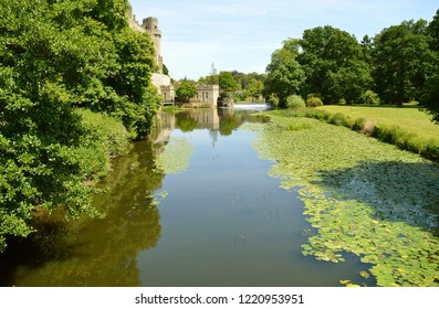 Warwick, Warwickshire, England, United Kingdom - June 24, 2018 : The tranquil River Avon flowing past Warwick Castle