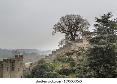 Warwick, Warwickshire / UK - March 2019: Warwick Castle grounds looking at 'The Mound' on a grey day.