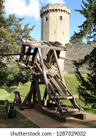 Warwick, West Midlands / United Kingdom - September 2011: Catapult at Warwick Castle and Knight's Village, a historic building from the 11th century