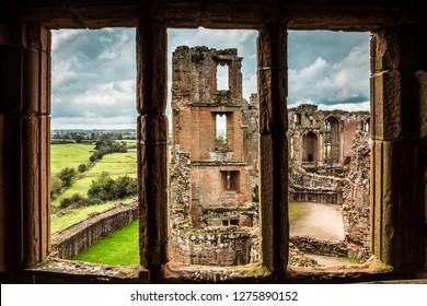 WARWICKSHIRE, ENGLAND - OCTOBER 11, 2014:  View of historic Medieval Castle ruins, Kenilworth in Warwickshire, United Kingdom seen though window
