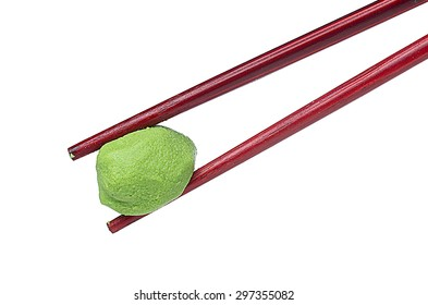 Wasabi in chopsticks isolated on white background