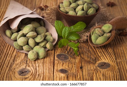 wasabi nuts on wooden table