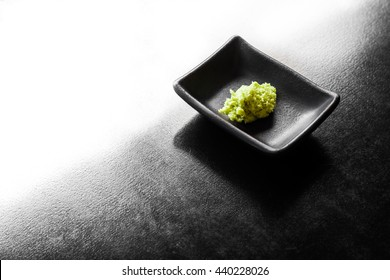 wasabi on a black plate top view