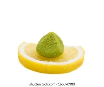 Wasabi on lemon isolated on white background