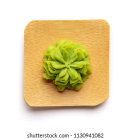 Wasabi portion on bamboo plate.