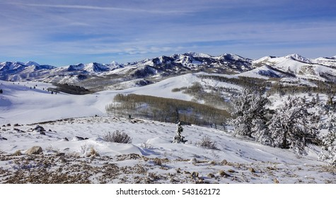 The Wasatch Mountain Range viewed from the top of the Deer Valley Ski Resort, site of 2002 Olympics, near Park City, Utah, a short drive from Salt Lake City on a partly cloudy winter day in December.