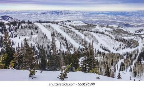 The Wasatch Mountain Range viewed from the top of the Park City  Ski Resort, Utah, close to The Canyons and Deer Valley, a short drive from Salt Lake City on a partly cloudy winter day in December.