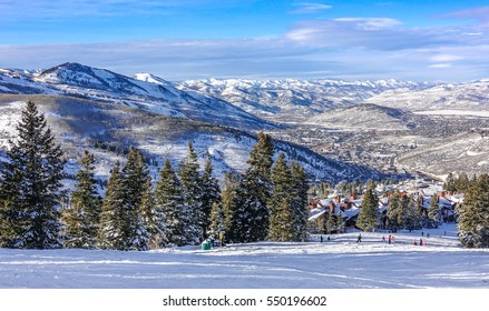 The Wasatch Mountain Range viewed from the top of the Deer Valley Ski Resort, near Park City, Utah, a short drive from Salt Lake City on a partly cloudy winter day in December.
