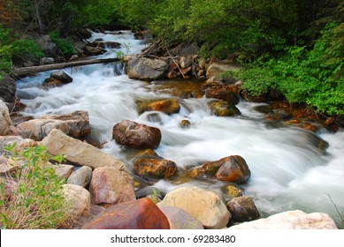 Wasatch Mountain Stream flows over rocks and boulders in Utah.
