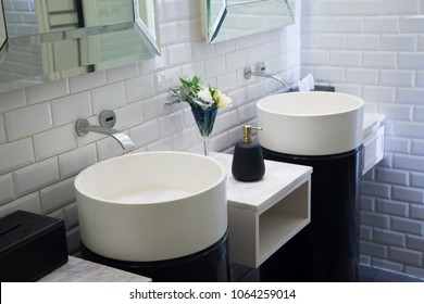 Wash basin and mirrors in the white bathroom. Beautifully decorated