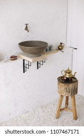 Wash basin vintage. Retro stoned sink. romantic vintage bathroom interior. Design loft in a modern style with wood and concrete.