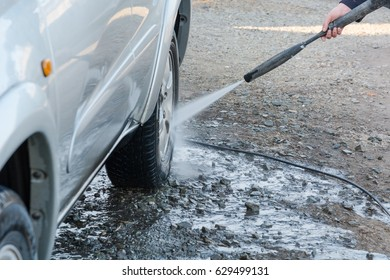 To wash the car with the high-pressure apparatus. To wash with water the car in house conditions