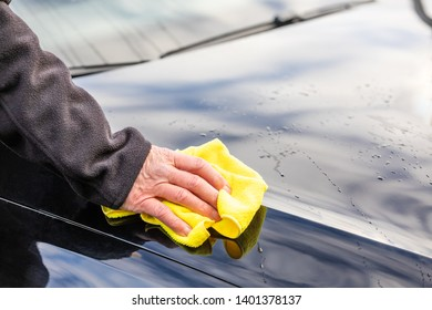 Wash the car with a rag