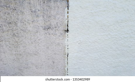 wash cleaned wall house facade and a dirty one in a city town, before and after