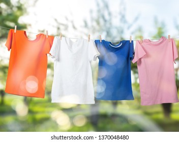 Wash clothes on a rope with clothespins on background
