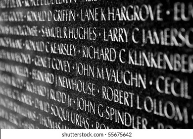 WASH DC - CIRCA JUNE 09: Names of Vietnam war casualties on Vietnam War Veterans Memorial circa June 09 in Washington DC, USA. Names in chronological order,from first casualty in 1959 to last in 1975.