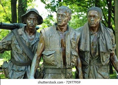 WASH DC - CIRCA JUNE 09: Sculptures of Vietnam War Veterans Memorial circa June 09 in Washington DC, USA. The Memorial receives around 3 million visitors each year.