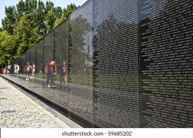 WASH DC -JULY 14: Names of Vietnam war casualties on Vietnam War Veterans Memorial on July 14,2010 in Washington DC, USA. Names in chronological order,from first casualty in 1959 to last in 1975.