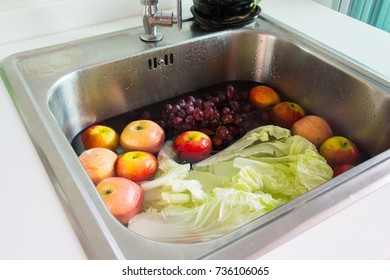 wash fresh fruit and vegetable in sink