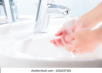 Wash hands in the bathroom