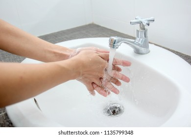 Wash hands with disinfectants in a healthy bathroom.