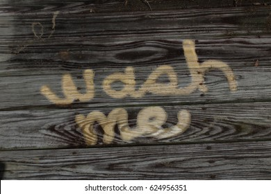 Wash me concept power washed dirty wood
