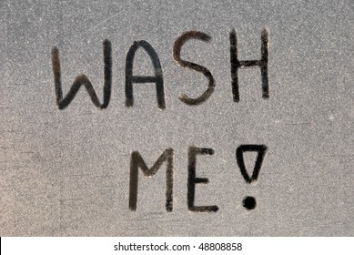 """Wash me"" written on a dirty car"