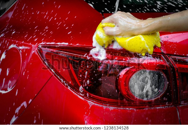 Wash a red car with copy space, can use for design.