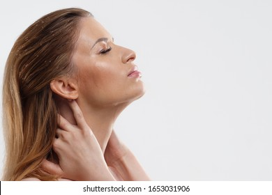 Wash your face and take care of your skin. Portrait of a young woman with beautiful clear skin, close-up on a white background. Skin care, cleansing and moisturizing