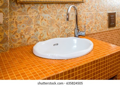 Washbasin with chromed faucet