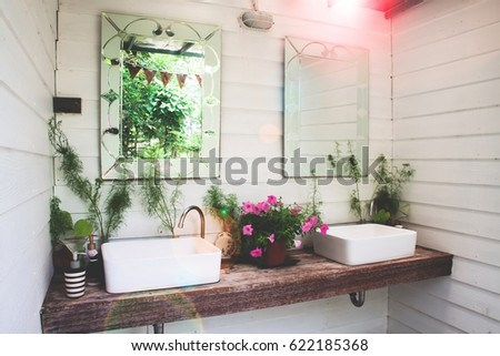 Washbasin with nature in home garden, White and beautiful concept