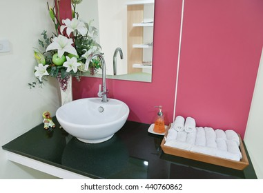 Washbasin with a white towel