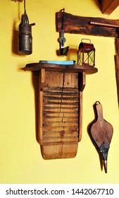 Washboard, oil lamps, bellow. Old utensils that were used in the spanish kitchen of a village house
