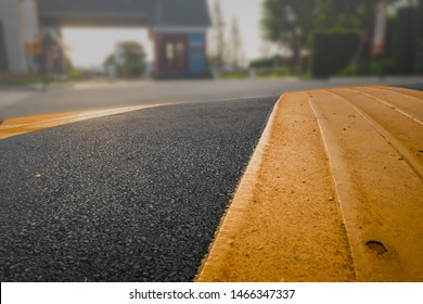 Washboard road on asphalt surface painted with different color of black and dark yellow speed bump or speed breaker