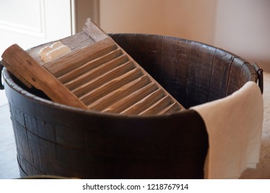 washboard with a towel in a bucket