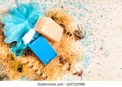 Washcloth and soap on wooden background