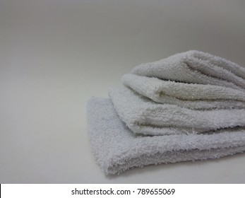 Washcloths on a plain background
