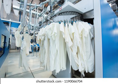 Washed clothes are being conveyed to ironing machine