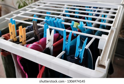 Washed clothes on a drying rack