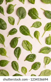 Washed fresh spinach on the marble table