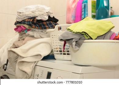 Washed laundry on the washing machine and dryer