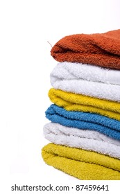 washed nicely color coordinated towels white background