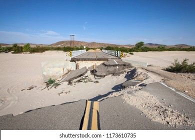 Washed out flood damaged highway road and bridge in the Mojave desert near Barstow, California.