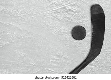 Washer and black stick on the ice hockey rink. Concept, background